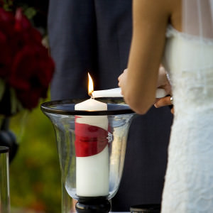 Lighting the Unity Candle during Wedding Ceremony